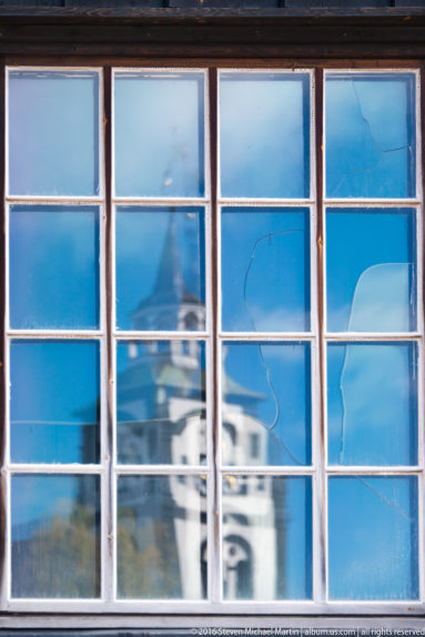 Reflection of Roros Church in window by Steven Michael Martin