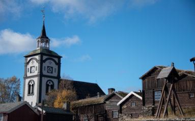 Roros Church among buildings by Steven Michael Martin